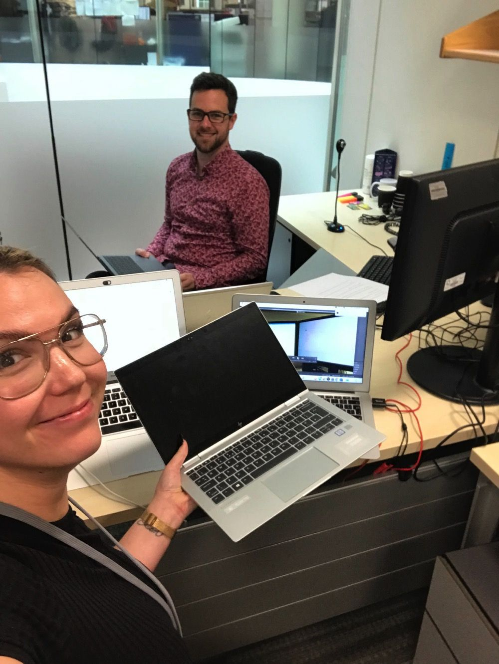 Harry and Urska on site at the clients offices wielding laptops